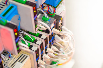 Cables are connected to modem. Electronic and Electrical Concept. Server equipment. Equipment for connecting electrical circuits. The electric wire. Cables PLC.