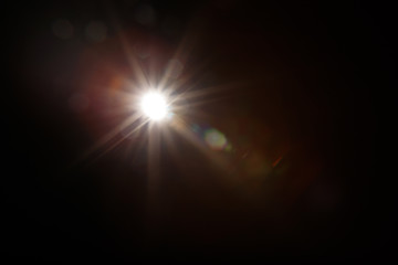 Lens Flare. Light over black background. Easy to add overlay or screen filter over photos. Abstract...