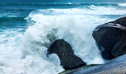 Powerful Ocean Wave Smashes Against Rock With Sea Foam Spray