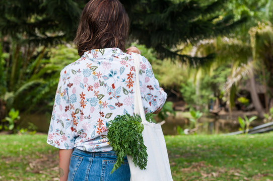 Woman with a shopping bag for organic vegetables