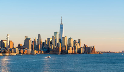 Fototapete - Beautiful scenic sunset evening view of lower manhattan, downtown of New York City, from Hoboken, New Jersey, over the Hudson river in USA. Famous attraction and iconic blue skyline view of america.