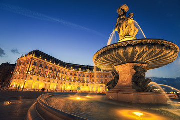 Three Graces fountain in Place de la Bourse. This square is one of the most representative works of classical French architecture. Fototapete