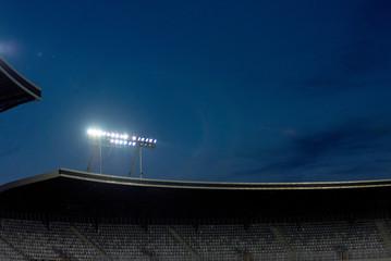 Stadium lights against blue sky