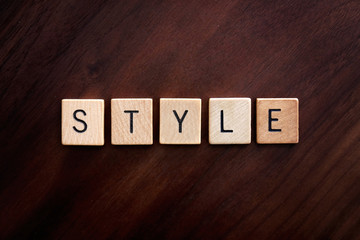 Word Style Spelled out in Wooden Letter Blocks on Dark Wood Background