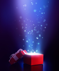 Red open gift box with magical light