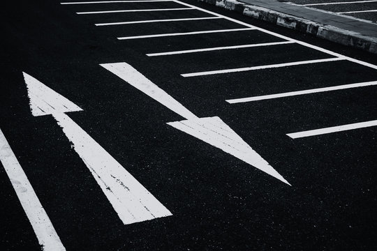 2 Ways two directions arrows paint on asphalt road. Conflicts Confusion concept.