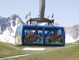 Pictures on a cable car of the Weisshornbahnen promote the Arosa Baerenland sanctuary in the mountain resort of  Arosa