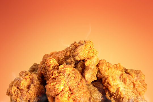 Fried chicken or crispy kentucky on hot background. Delicious hot meal with fast food.