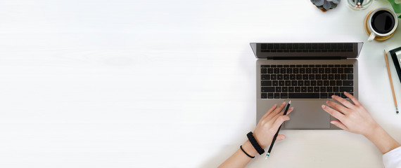 Fototapeta Female writer typing using laptop keyboard and wood copy space obraz