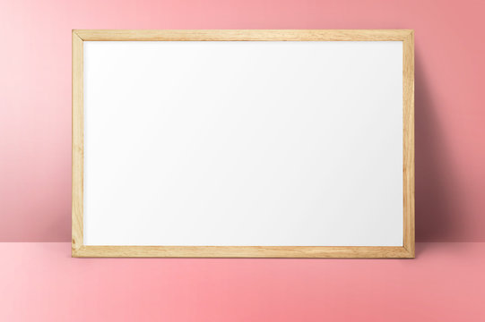 mock up with horizontal wood frame on pink wall background