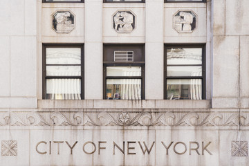 Facade of building with text City of New York