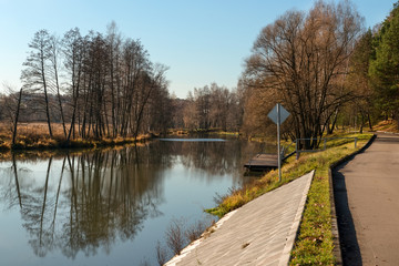 Embankment of the river in the autumn afternoon