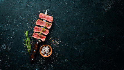 Juicy Steak on the knife. Top view. Free space for your text. Wall mural