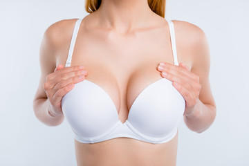 Cropped close-up photo of nice well-groomed girl touching perfect shape chest breast reduction cancer early diagnostic isolated over light gray background