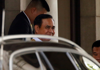 Thailand's Prime Minister Prayuth Chan-ocha smiles as he leaves from government house to swear in front of Thailand's King Maha Vajiralongkorn with his cabinet in Bangkok