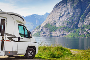 Camper car on fjord shore, Lofoten islands, Norway