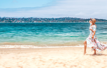 Woman in flowing dress on beach in Sydney Australia
