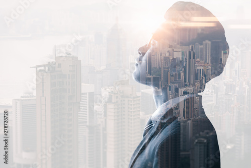 The double exposure image of the businessman seriously
