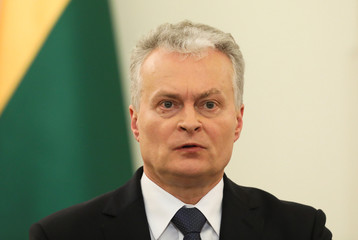 Lithuanian President Gitanas Nauseda attends a news conference in Warsaw