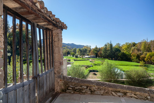 Sant Joan de les Abadesses, Catalonia, Spain. Landscape pyrenees mountain and rural village houses.