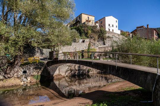 Sant Joan de les Abadesses, Catalonia, Spain. Village view, bridge and river, rural houses.