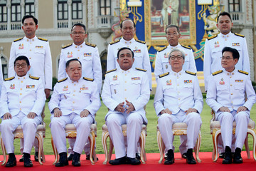 Thailand's Prime Minister Prayuth Chan-ocha and the new government cabinet pose for a photo in Bangkok