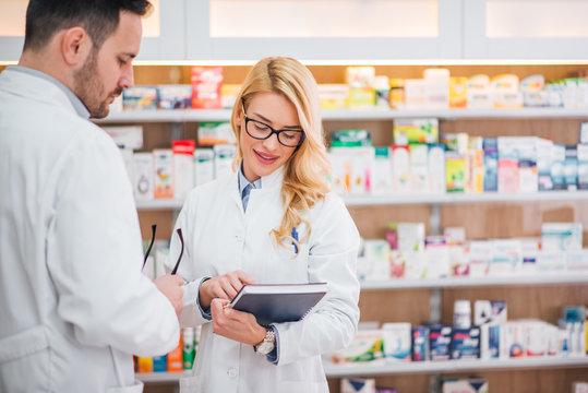 Two pharmacist working in drugstore.