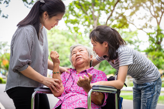 Sick senior grandmother with epileptic seizures in outdoor,elderly patient convulsions suffering from illness with epilepsy during seizure attack,asian daughter,granddaughter cry,family care concept