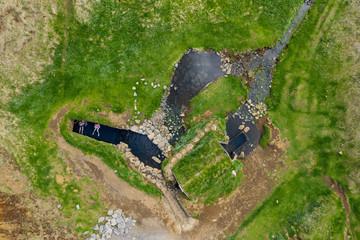 Aerial view of Hrunalaug hot spring, Fludir, Iceland