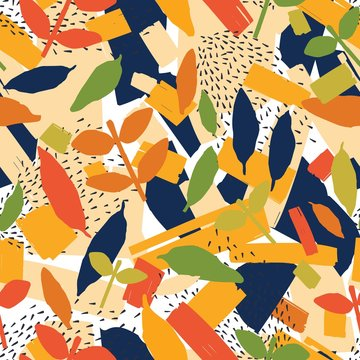 Artistic seamless pattern with colorful autumn foliage, paints stains and marks