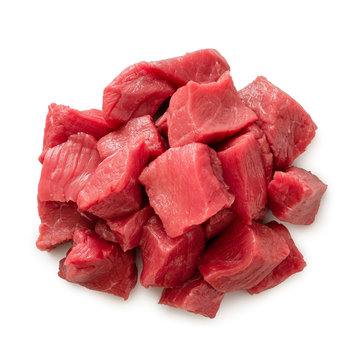 Pile of beef cubes isolated on white from above.