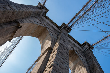 Close up view of Brooklyn Bridge in summer sunny daylight