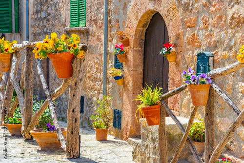 Fotolia.com & Beautiful window with flower pots and colorful flowers ...