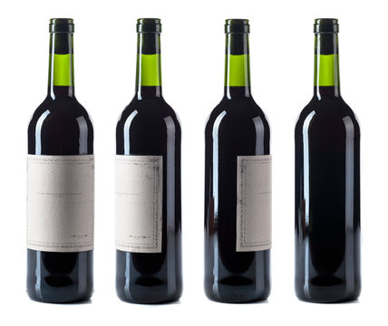 Red wine bottle isolated on a white background.