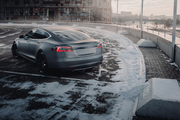 Moscow, Russia - January 10, 2018: Electric car Tesla Model S P85 wrapped in grey color matte vinyl is standing on the parking. Back view