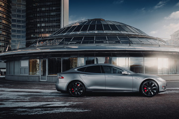 Moscow, Russia - January 10, 2018: Electric car Tesla Model S P85 wrapped in grey color matte vinyl is standing on the parking. Side view
