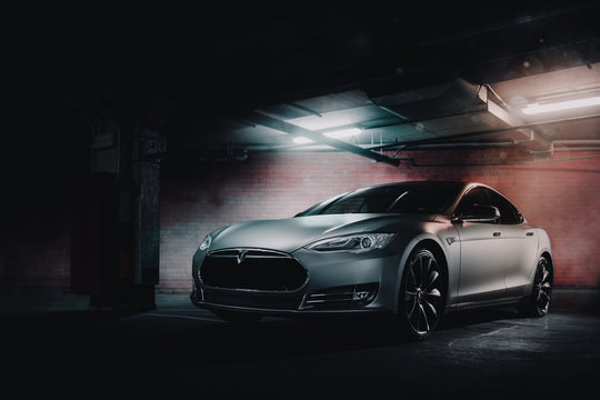 Moscow, Russia - January 10, 2018: Electric car Tesla Model S P85 wrapped in grey color matte vinyl is standing at underground parking