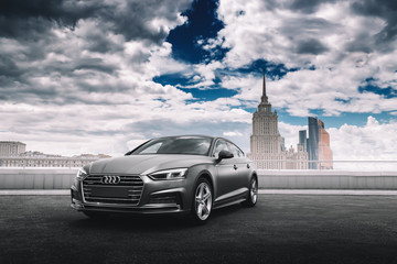 Moscow, Russia - June 17, 2017: Car Audi A5 wrapped in grey color matte vinyl is standing on the parking
