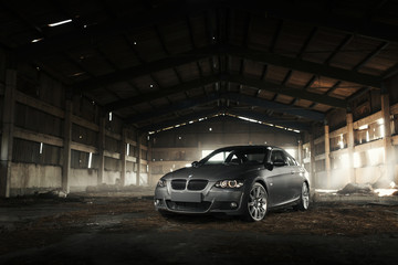 Minsk, Belarus - August 21, 2016: Car BMW Coupe E92 is parked in abandoned hangar