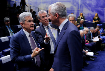 """French Finance Minister Le Maire talks with Governor of the Bank of France Villeroy de Galhau and Federal Reserve Board Chairman Powell during a conference entitled """"Bretton Woods: 75 years later"""" in Paris"""