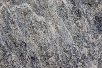 Dark gray stone porous surface. Gran abstract stone surface. Texture of stone.
