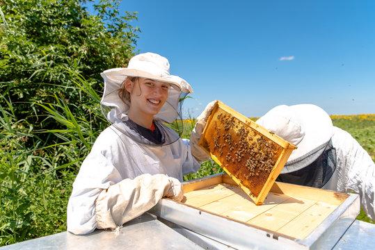 Young girl beekeeper