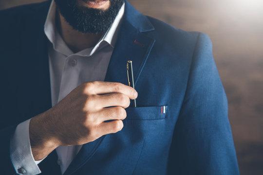 man hand pen in pocket