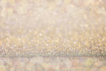 Abstract gold glitter bokeh lights background.