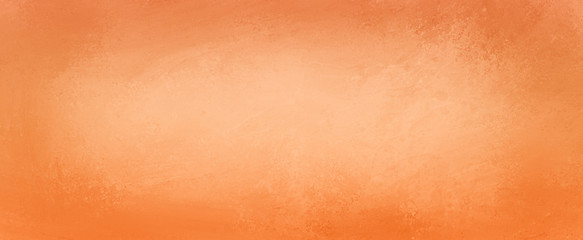 Orange background texture for autumn and halloween designs with soft peach or white center and dark border, old vintage background