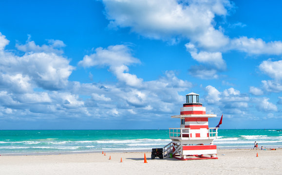 Tour of Miami beach colorful lifeguard towers. Quirky iconic structures. Lifeguard towers South Beach unique and worth taking leisurely stroll to see. Explore South beach. Striped lighthouse design