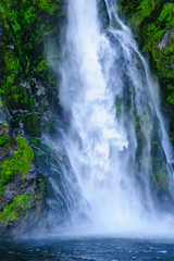 Huge waterfall in the Milford Sound, South Island, New Zealand