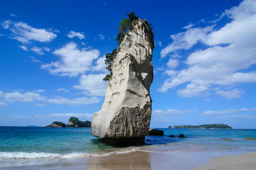 Giant rock on the sandy beach of Cathedral Cove, Coromandel, North Island, New Zealand