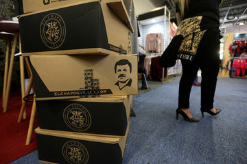 """Boxes with the image of Mexican drug lord Joaquin """"El Chapo"""" Guzman are seen at a stand of the clothing brand """"El Chapo 701"""" at the Intermoda fair in Guadalajara"""