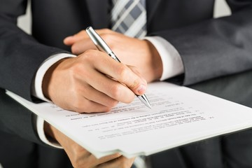 Closeup of a Businessman Signing a Contract